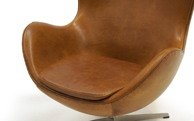 Aluminum Pair Arne Jacobsen Egg Chairs with Ottomans, Cognac Leather. Price is for all.