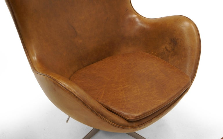 Pair Arne Jacobsen Egg Chairs with Ottomans, Cognac Leather. Price is for all. 1