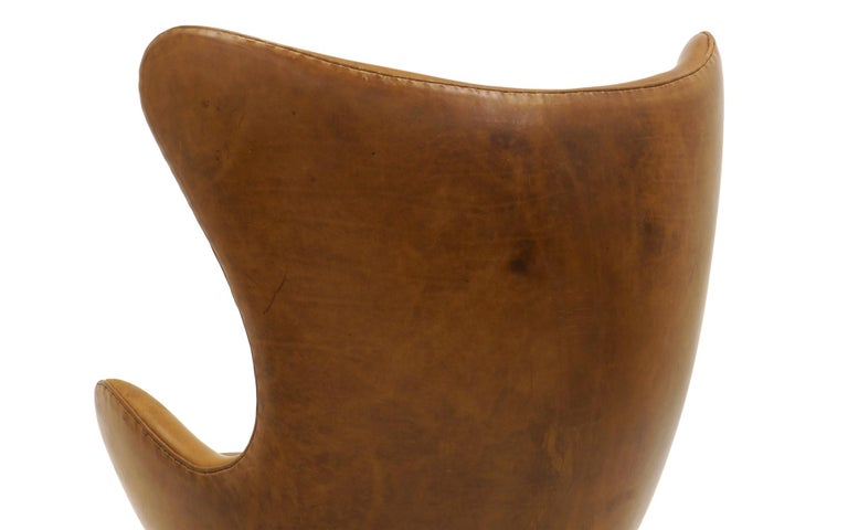 Pair Arne Jacobsen Egg Chairs with Ottomans, Cognac Leather. Price is for all. 2
