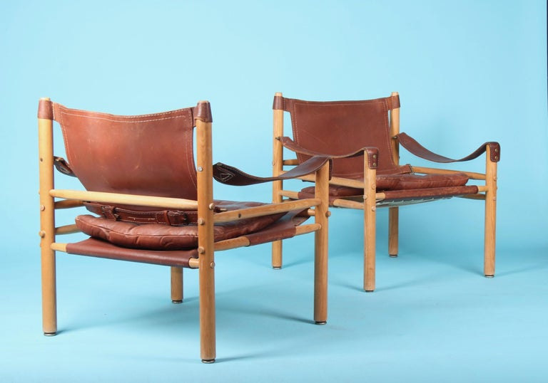 Pair of Arne Norell easy chairs Model Sirocco, 1960s, some scratches on the leather and wear from use.