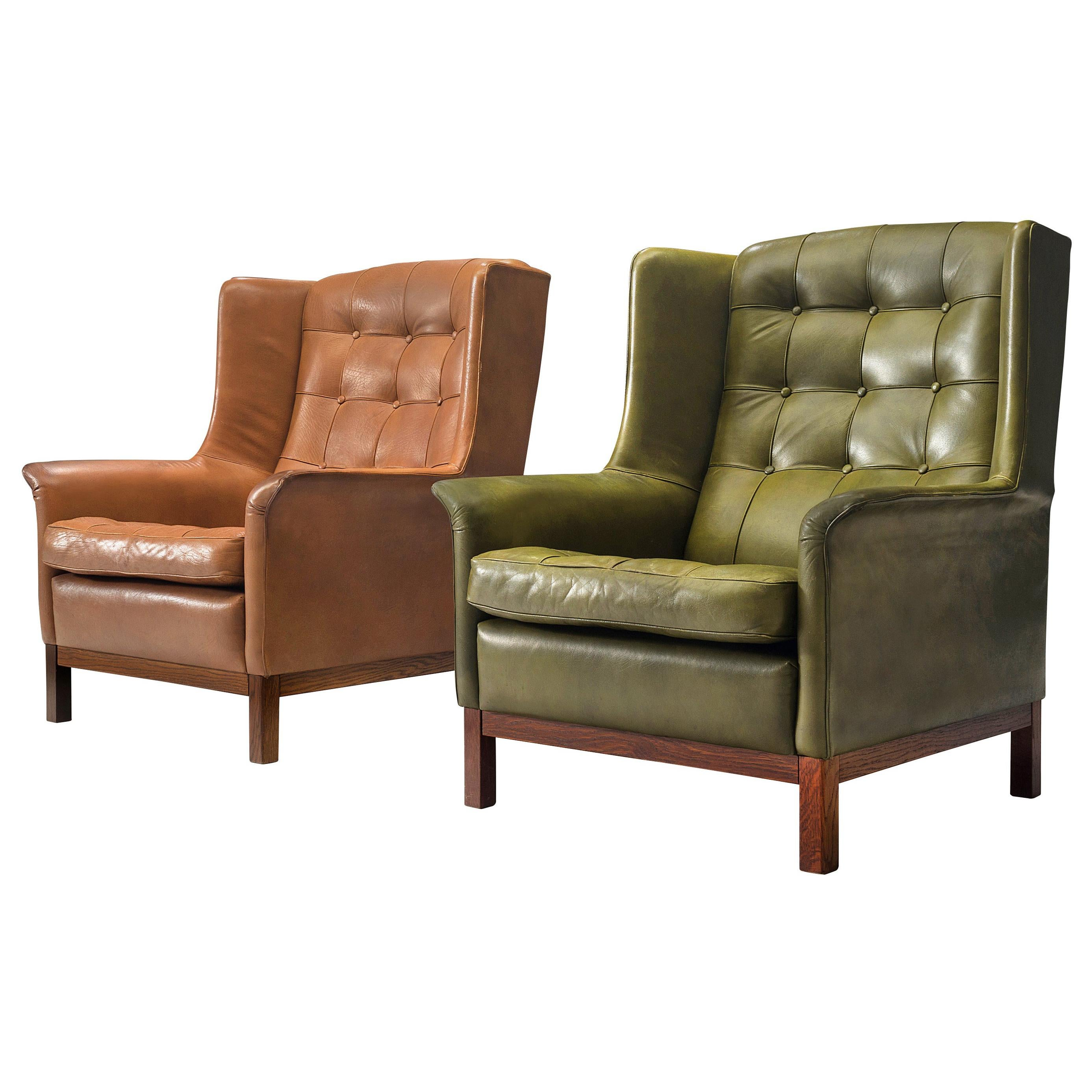 Pair of Arne Norell Lounge Chairs in Patinated Green and Cognac Leather