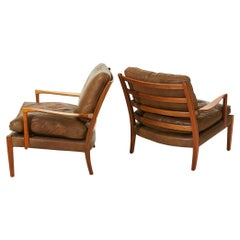 """Pair of Arne Norell """"Löven"""" Easy Arm Chairs in Walnut and Leather, Swedish 1960s"""