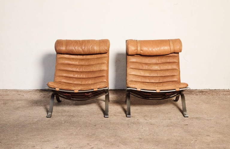 A stunning pair of Arne Norell Ari Chairs, Norell Mobler, Sweden, 1970s. In rarely seen cognac / tan buffalo leather. In great original condition. Ships worldwide.
