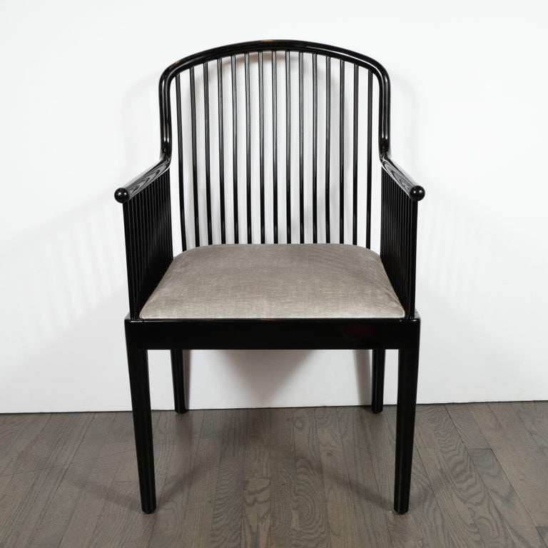 This elegant pair of Art Deco armchairs were realized in America, circa 1980 by Paul Davis for Stendig. Inspired by the designs of Bauhaus and Wiener Werkstätte, these chairs offer an abundance of cylindrical slats creating a dramatic and graphic