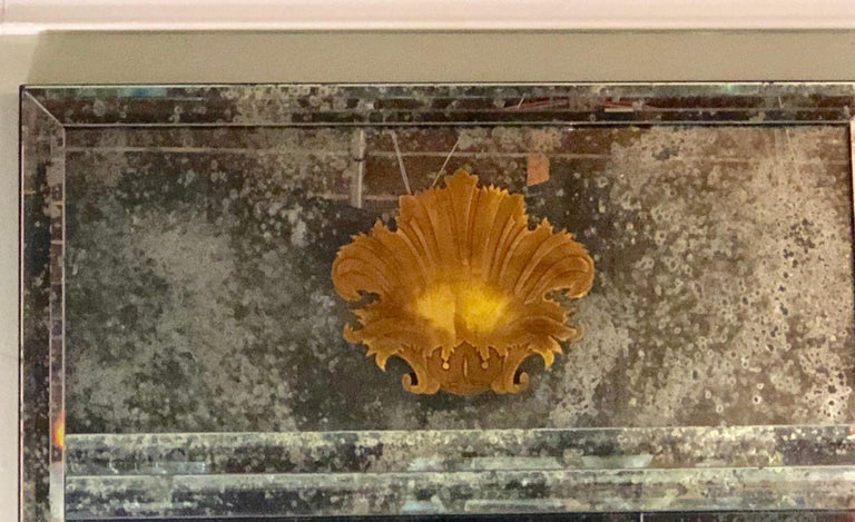 Glass Pair of Art Deco Beveled Console or Wall Mirrors with Engraved Gilt Shell Motif For Sale