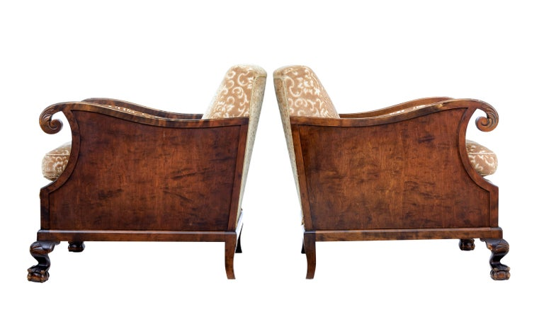 Fine pair of late Art Deco birch armchairs, circa 1940.  Elegant pair of armchairs, with scrolling arms and carved acanthus leaves to the arm. Paneled sides. Standing on ball and claw feet with shells to the knee.  Removable seat