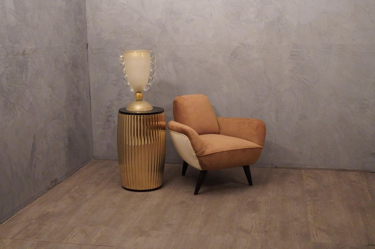 Elegant pair of armchairs in fine white and brown fabrics, very special design.  All covered in white and brown fabric. The armchairs are formed by a round seat with around a band that acts as armrests and backrest. Furthermore, in the back part