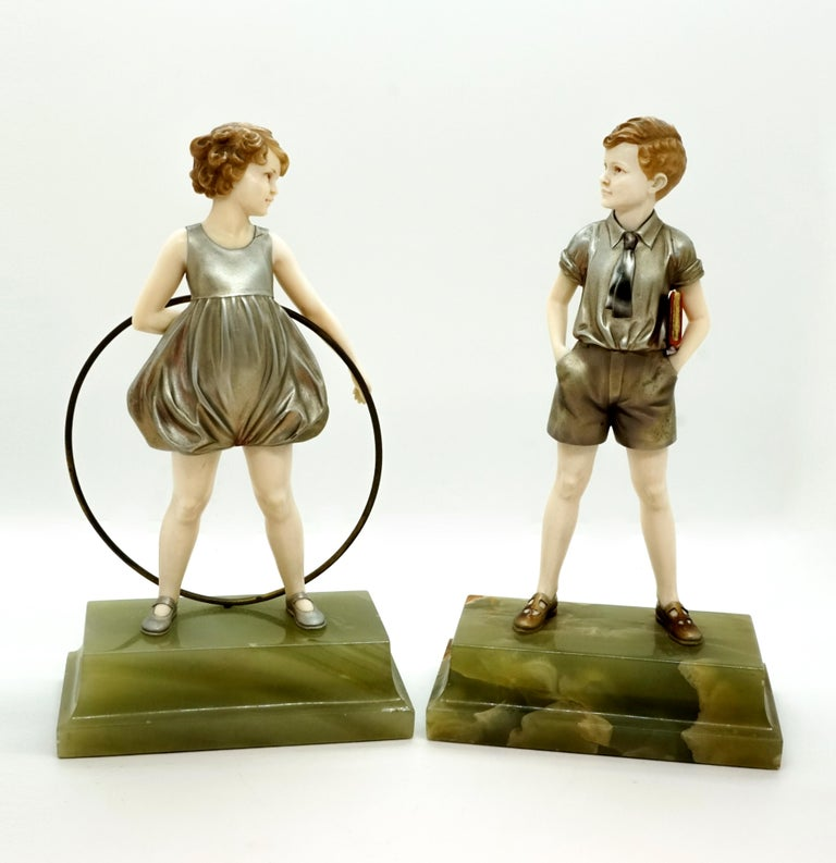 Two dainty, finely crafted children's figures:
