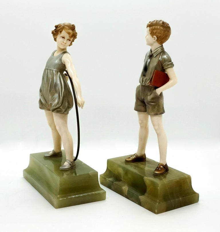 Hand-Carved Pair of Art Deco Child Figurines 'Hoop Girl' & 'Sunny Boy' by Ferdinand Preiss For Sale