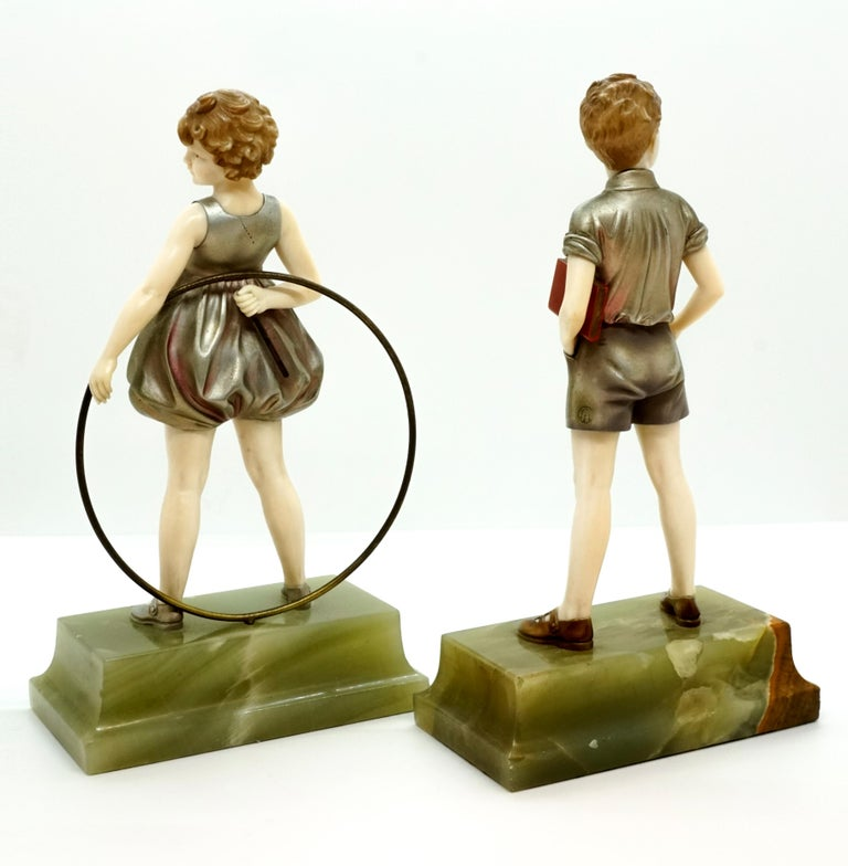 Pair of Art Deco Child Figurines 'Hoop Girl' & 'Sunny Boy' by Ferdinand Preiss In Good Condition For Sale In Vienna, AT