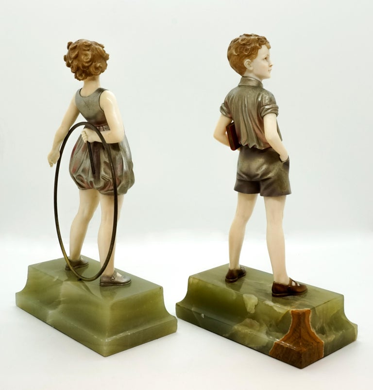 Early 20th Century Pair of Art Deco Child Figurines 'Hoop Girl' & 'Sunny Boy' by Ferdinand Preiss For Sale