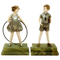 Pair of Art Deco Child Figurines 'Hoop Girl' & 'Sunny Boy' by Ferdinand Preiss
