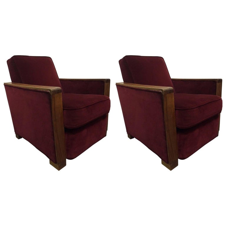 Chairs retain original velvet fabric with walnut arms and trim. Attributed to Jacques Adnet. Lounge chairs.