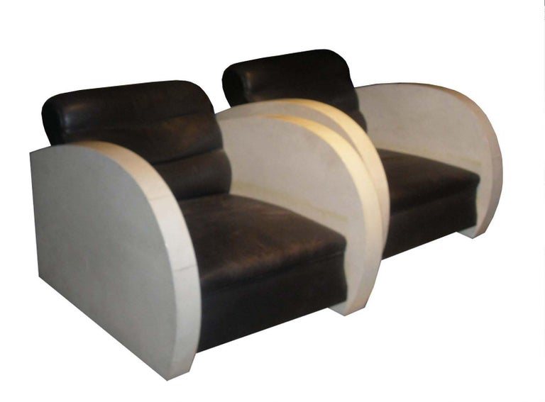 Pair of Art Deco club chairs in parchment and black leather.