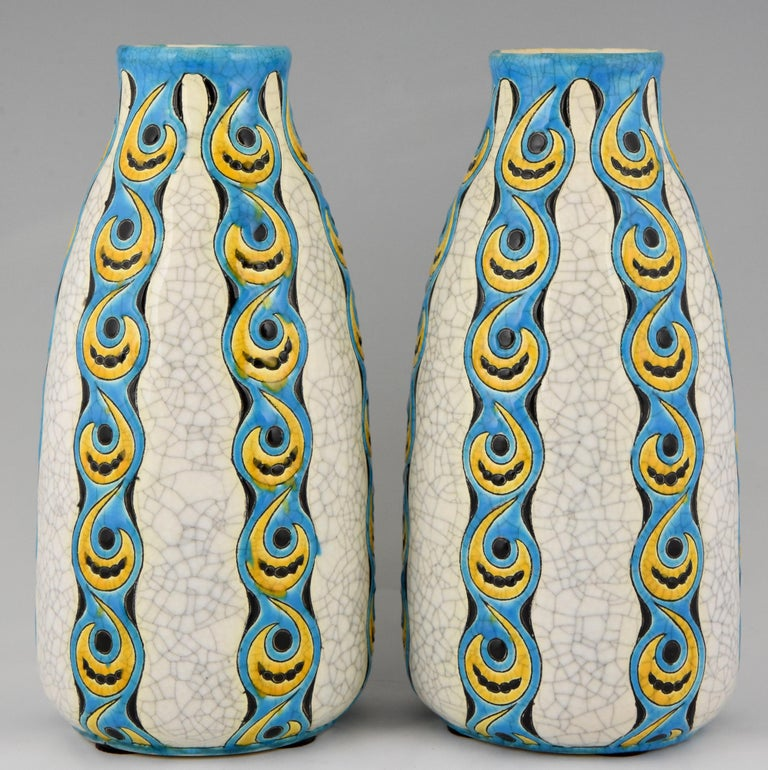 """A pair of Art Deco yellow, turquoise and white craquelé vases by Charles Catteau for Boch Freres. Belgium 1922.   This decor is illustrated in ?""""L'homme de Keramis"""" Charles Catteau by Dominique Corrieras More information: """"Catteau"""", donation"""