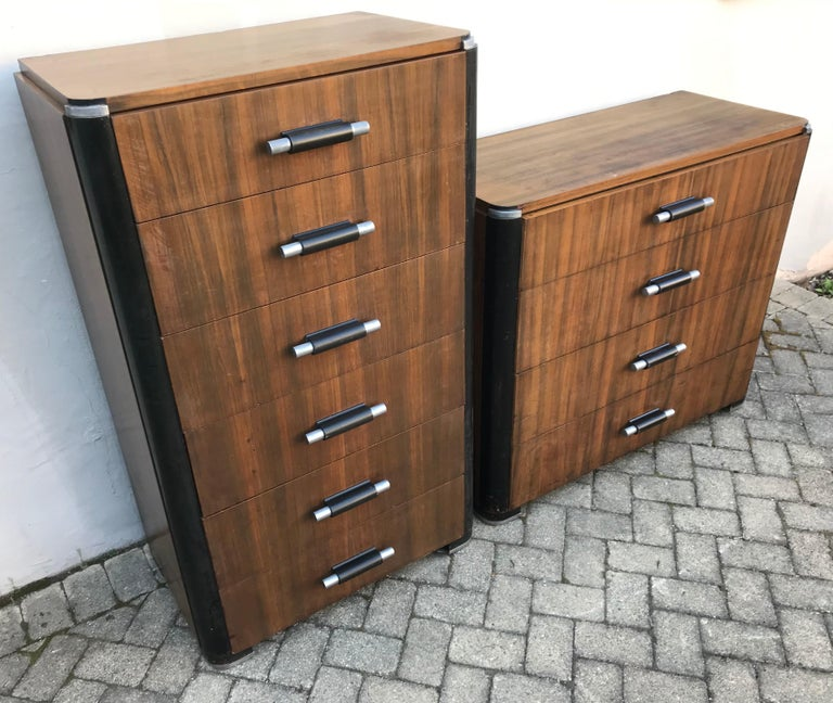 Exceptional pair of Art Deco dressers by Donald Deskey for Valentine Seaver Company circa 1930. Very rare in East Indian Rosewood veneer, all original aged condition, no missing hardware or repairs.   Professionally cleaned but keeping beautiful