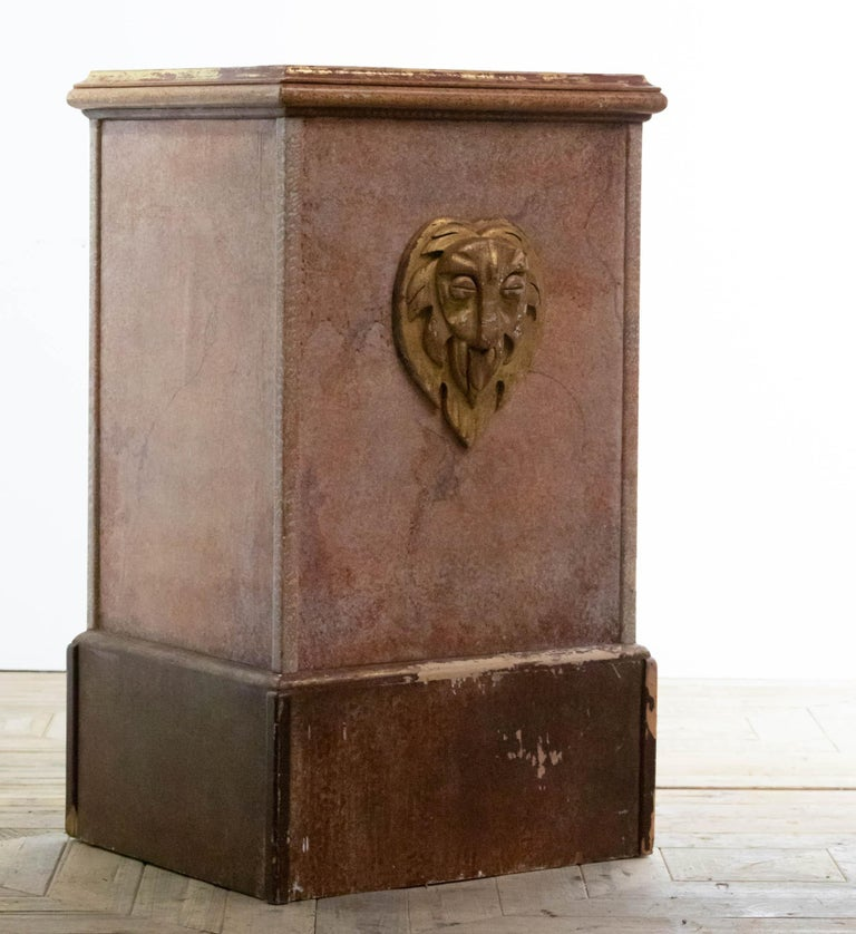 A stunning and impressive large pair of painted square end or console tables / plinths. Constricted from pine and plywood and retain their original marbled paint finish and applied gilt stylized lions mask. In places the gilding and paint has worn