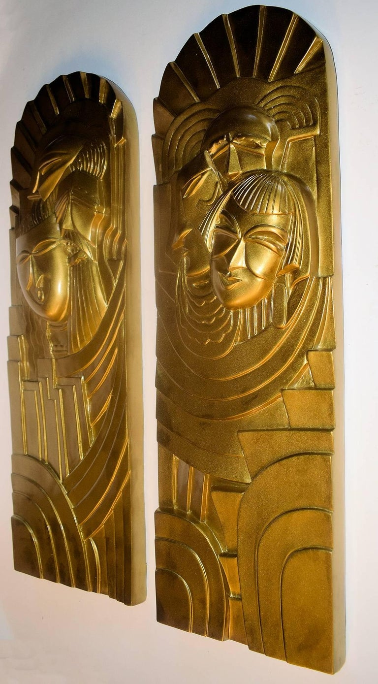 This is a super rare opportunity to acquire a pair of these beautifully reduced versions of the facade bas-relief of the Folies-Bergères cabaret. One time designer, Pico who created the central dancing lady facade over the entrance to the Folies