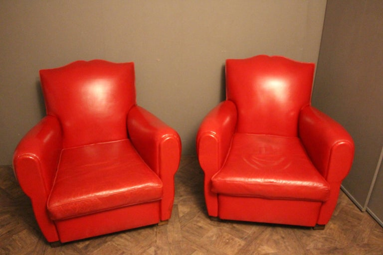 This pair of French club chairs features a vibrant poppy red color and a very nice mustache shaped back.