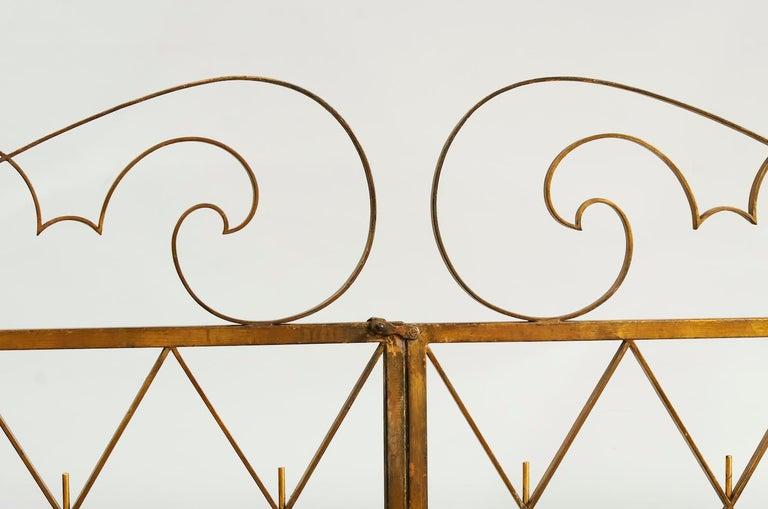 Pair of Art deco Gilded iron gates France 1940s Measures: W. 2 x 102 cm, total 204 cm H. 125 cm (highest part).