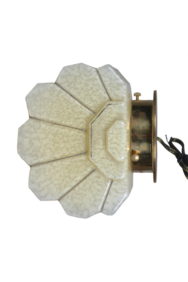 A fabulous pair of Art Deco glass sconce shades mounted on brass back plates. A soft off-white with great dimension. Originally European and rewired for American use. Takes a standard base bulb.