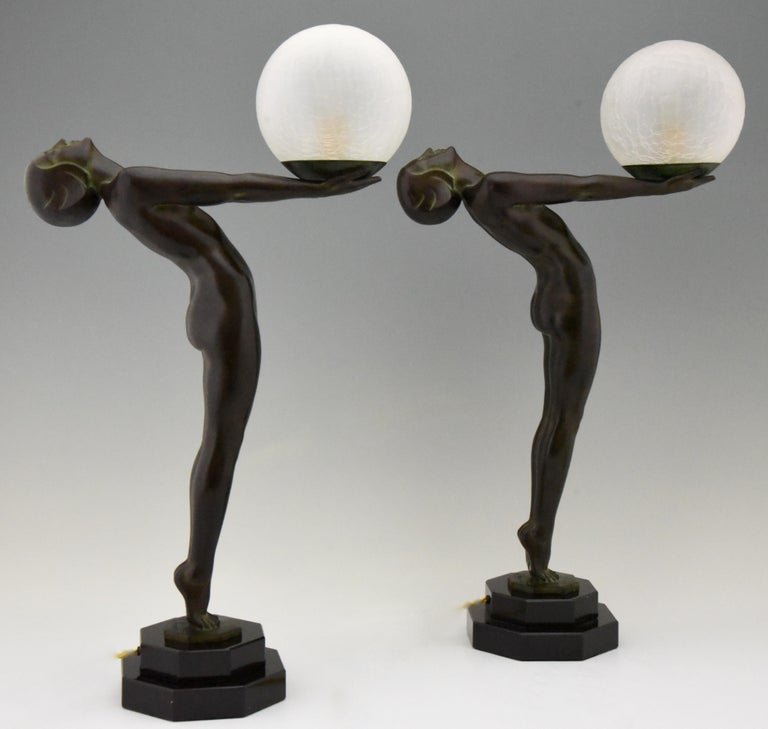 Patinated Pair of Art Deco Style Lamps Lumina Standing Nude Sculpture Max Le Verrier For Sale
