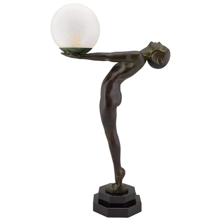 Impressive pair of Art Deco figural table lamps of a standing nude holding a glass shade, Lumina. H. 65 cm or 25.6 inch tall. Designed by Max Le Verrier in France, 1928. Original posthumous contemporary cast at the Le Verrier foundry. Signed and
