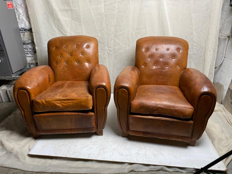 Great pair of French Art Deco leather club chairs with original leather in good condition, patination and color.