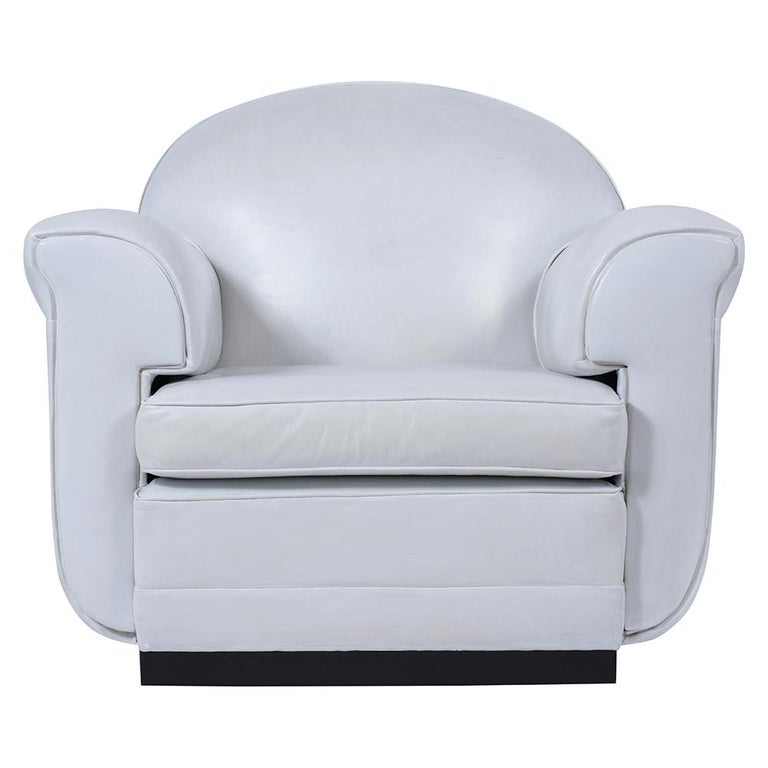 An extraordinary pair of comfortable French lounge chairs covered in white leather upholstery in good condition. This sleek modern design set of chairs feature removable cushions thickly padded armrests comfortable backrests still covered with its