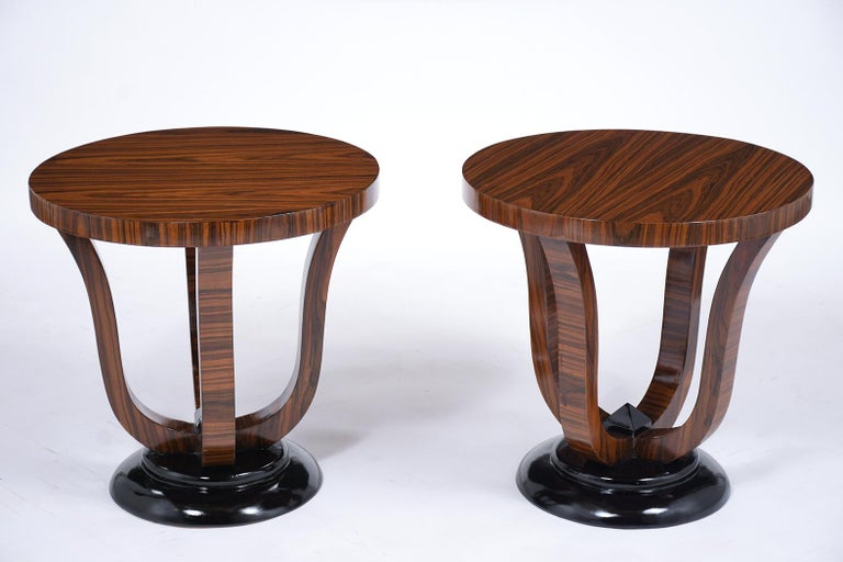 This pair of French Art Deco Macassar Side Tables are in great condition, have ebonized details, and a newly lacquered finish. These end tables are covered in their original Macassar veneer, circular round top, and rests on a sturdy pedestal base