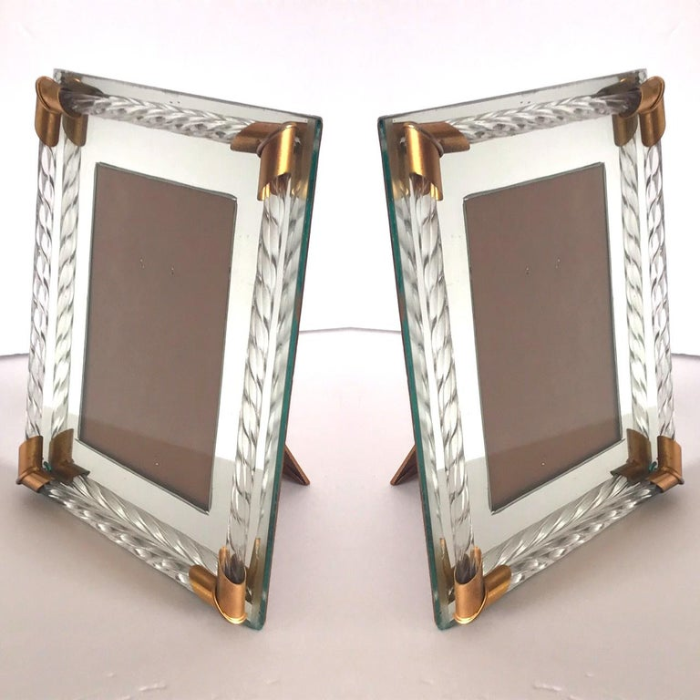 Pair of gorgeous Italian Hollywood Regency mirrored picture frames with Murano glass rods in the form of twisted rope. The picture frames hold 4