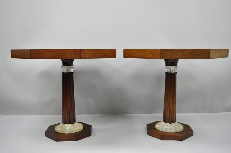 A pair of Art Deco French style octagonal mahogany pedestal base side tables with acrylic, Lucite accents attributed to Grosfeld House. Item features sunburst inlaid mahogany top, carved column pedestal base with acrylic leafy accents to the columns