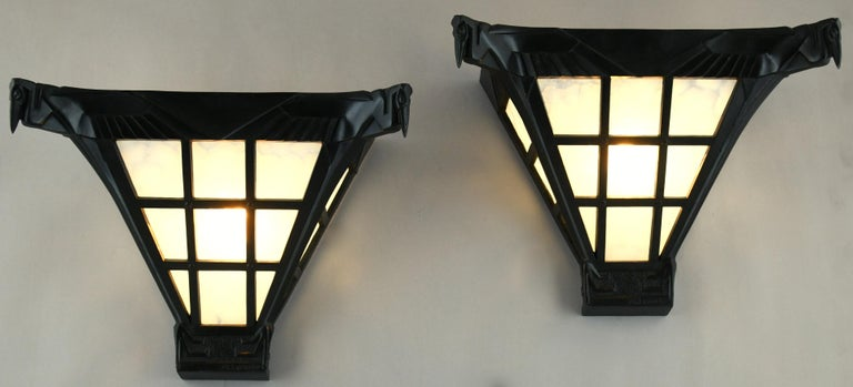 Hard to find pair of Art Deco wall lights or sconces with pelicans by Max Le Verrier, France, 1930. The metal frame has a dark green patina and holds the original opaline cloudy glass. We have bought a complete set with pendant light and a unique