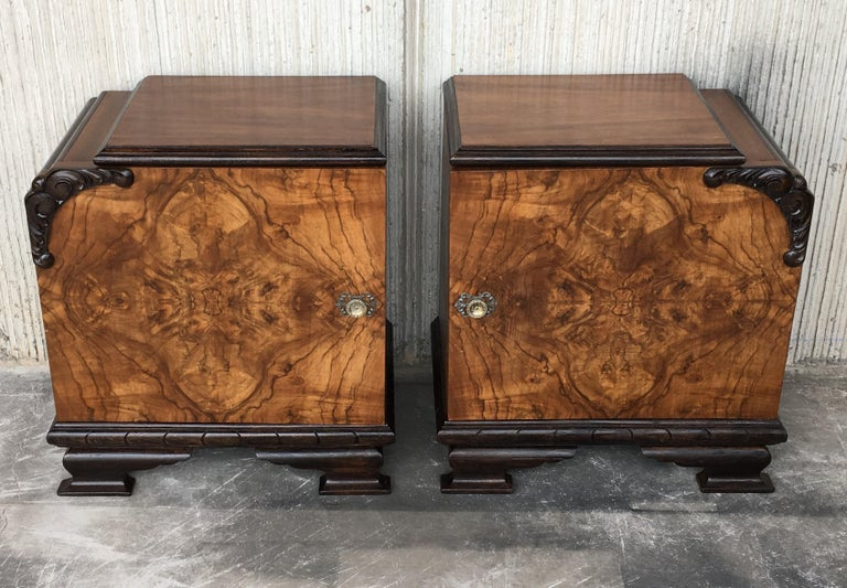This pair of circa 1930s French Art Deco side cabinets could be used to flank a sofa or as nightstands. Each has a storage compartment with hinged door and narrow open shelves at the sides. One-drawer and one ceramic box. Cabinets are set on