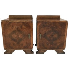 Pair of Art Deco Side Cabinets or Nightstands with Ebonized Base and Crest