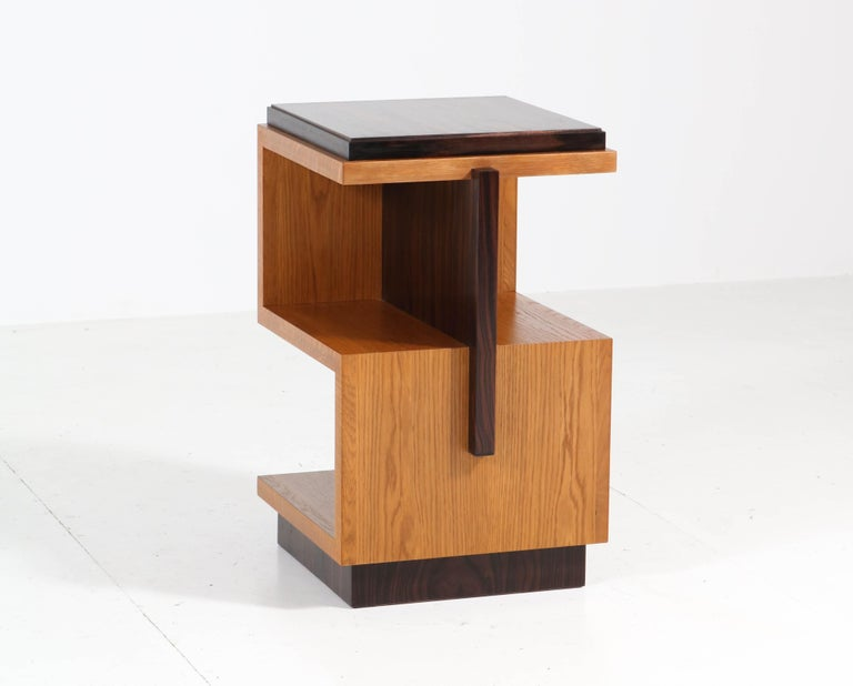 Magnificent pair of Art Deco style Haagse School style side tables. This wonderful pair is designed by Amsterdam Modernism and executed by our cabinet makers Fa. Raaf. Solid oak Z-shaped base with ebony Macassar veneered top and lining. Executed