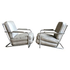 Pair of Gilbert Rohde Lounge Chairs In Chrome and Leather