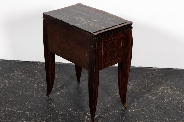 Pair of Art Deco style nightstands with a single drawer. The piece also features diamond shaped detail on the drawer front. Please note of wear consistent with age including chips and minor finish loss.