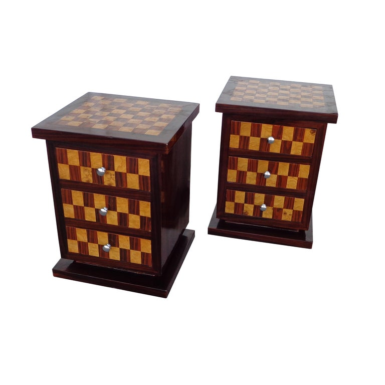 Pair of Art Deco style nightstands or side tables  Nightstands with a checkerboard pattern exotic wood parquetry on top and sides. Three drawers with nickel pulls.  Beautifully finished backs.