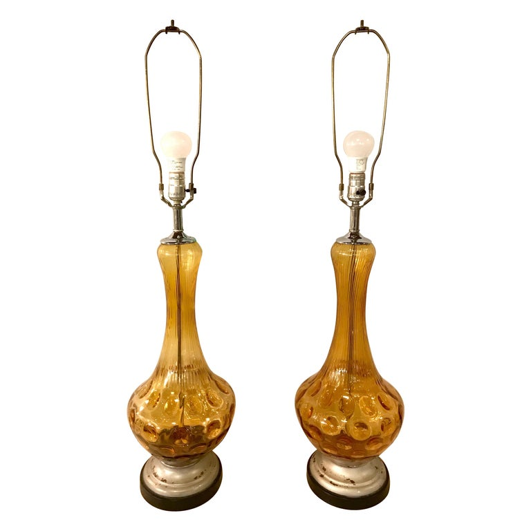 Pair of Art Deco Style Sculpted Amber Glass Lamps For Sale