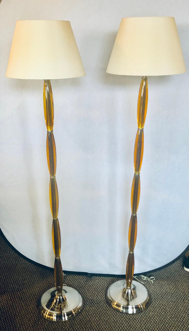 Pair of Art Deco tall Murano glass style standing lamps each on chrome bases. Shades not included.