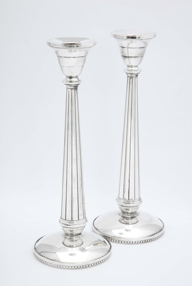 Pair of Art Deco, tall sterling silver candlesticks, The Webster Silver Corp., North Attleboro, Mass., Ca. 1930's. Each candlestick measures 9 inches high x almost 3 3/4 inches diameter across its base x 2 inches diameter across candle cup. Some