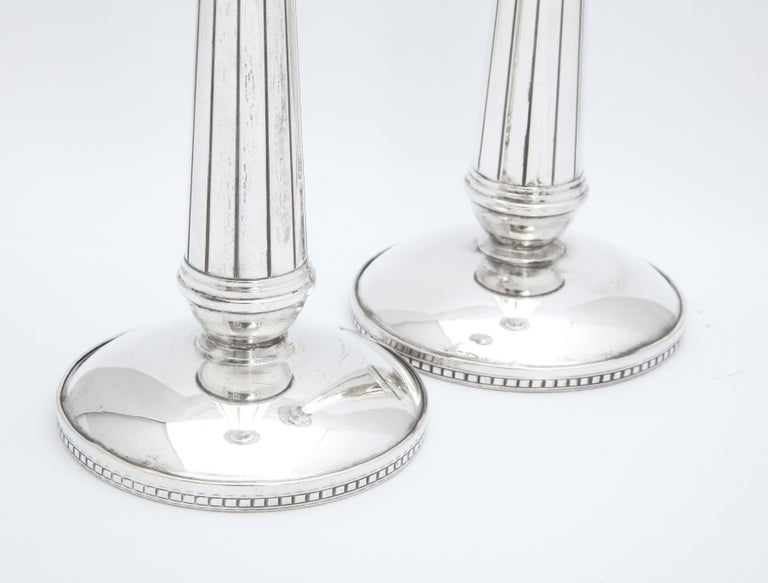 Mid-20th Century Pair of Art Deco Tall Sterling Silver Candlesticks For Sale