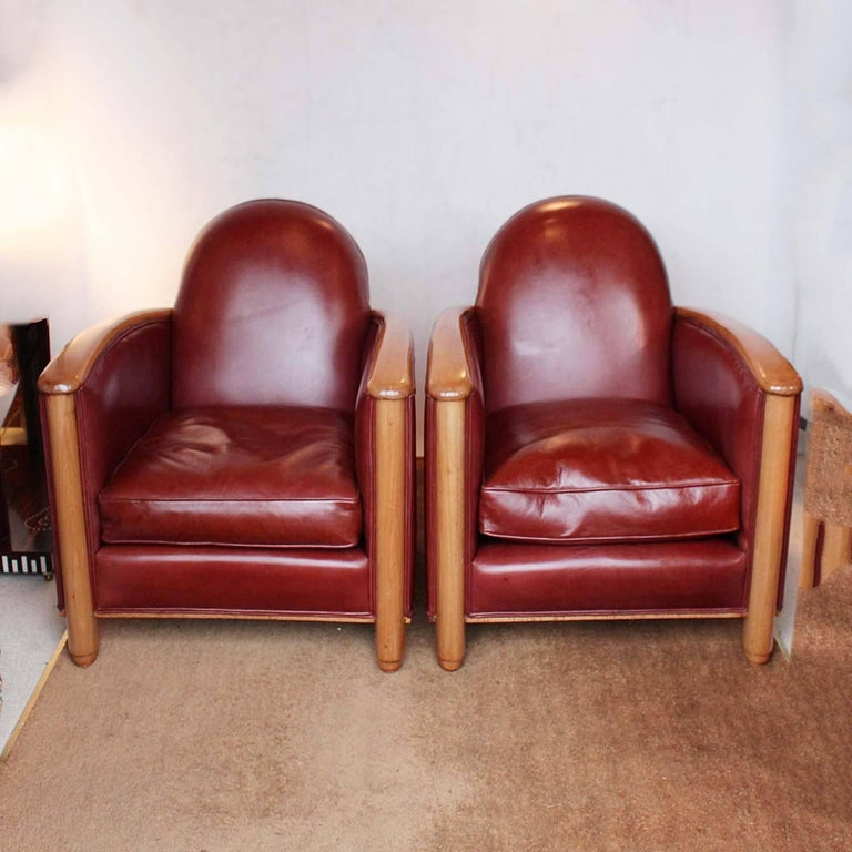 A pair of Art Deco chairs. fruitwood arms and legs, upholstered in chestnut leather.