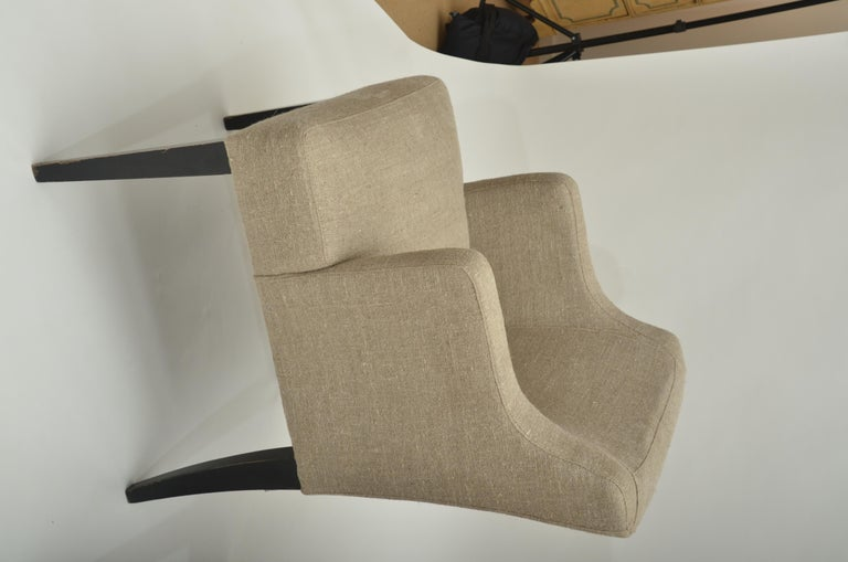 Armchairs have ebonized tapered legs and are newly upholstered in natural French linen.