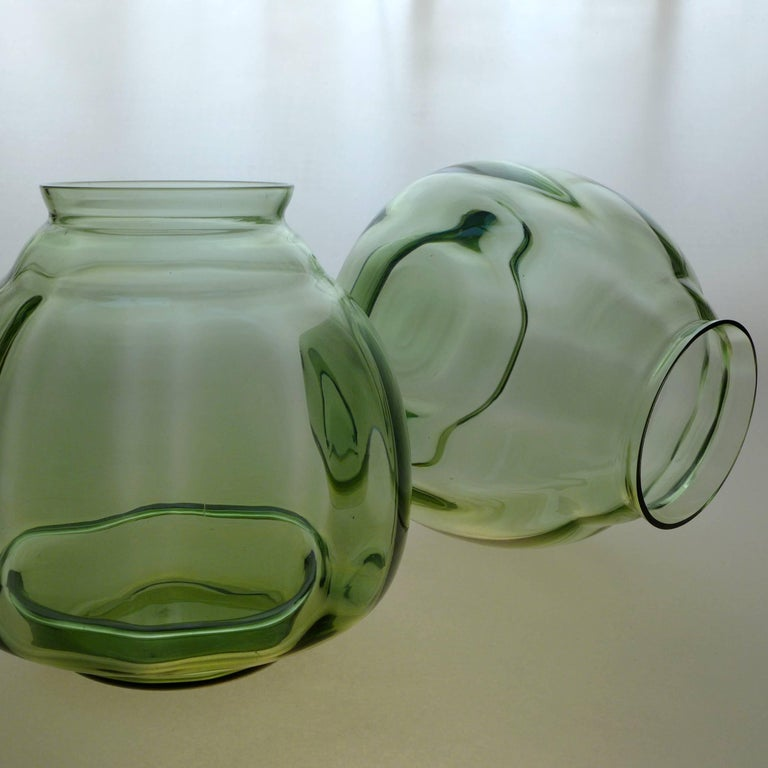 A pair of Dutch Art Deco Flora vases designed by A. D. Copier.  Andries Dirk Copier is one of the most revered glass designers of his time — a leader in the Art Deco 'Amsterdam School' style. Leerdam Glass is known for clean, simple, organic forms