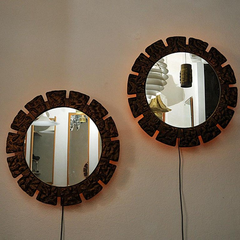 A pair of rare and beautiful Art Deco wall mirrors with lovely ligth flowing out in the back. Gives a nice and shiny light in darker rooms. Massive decorated and painted frame with attractive sculpture decorations around. Mirrors and light