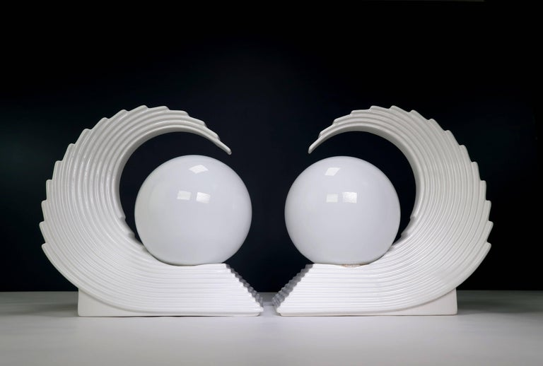 Stunning and highly decorative modernist Art Deco style statement table lamps likely from the late 1970s-early 1980s. Warm white globe mounted on elegant sculptural ceramic base shaped as a large cubist jagged wave reminiscent of Hokusai's Great