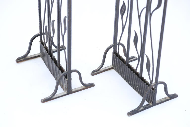 Pair of Art Deco gates, now a screen or room divider, of wrought iron, each side having a scalloped arch, inset with scrolling foliate vines.  Stock id: D1841.
