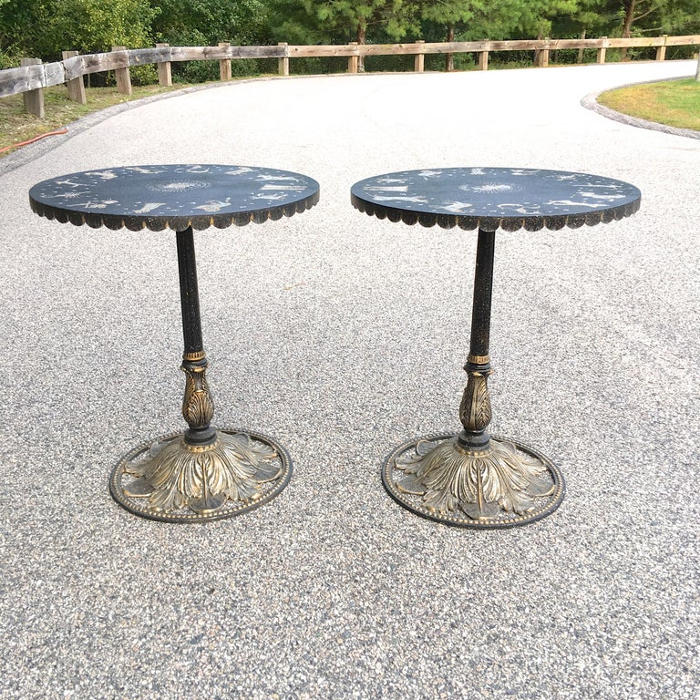 Pair of Art Deco style patinated metal round bistrot tables with stylized figures of the zodiac and a constellation of scattered stars incised and silvered on the tops.   Sold as a pair.